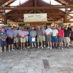 The huge group of golfing contestants pose for a picture