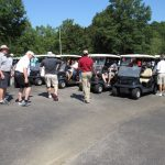 The golfers getting into their golf carts