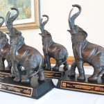 Trophies of elephants with their trunks up