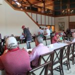 A view of the tables inside where golfers are enjoying a meal